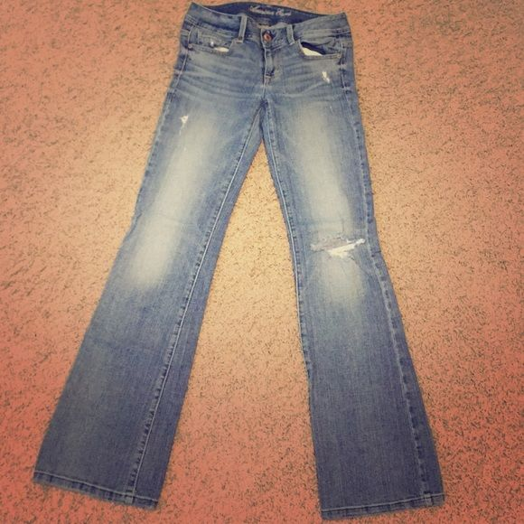 American Eagle Jeans Size 4 Regular Original Boot cute jeans! They are in good condition a little work on the bottom but not too bad! These are super comfy and make your booty look bomb! Any questions please ask!☺️ American Eagle Outfitters Jeans Boot Cut