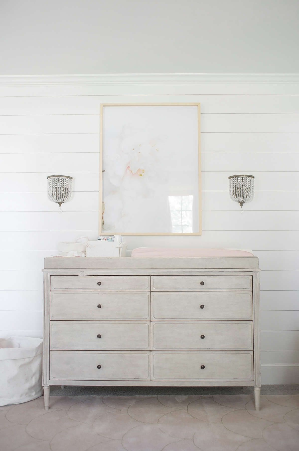 lay baby lay classic, polished pink nursery reveal. featuring our marcelle wide dresser & topper, pink star canvas storage and dauphine crystal sconces.