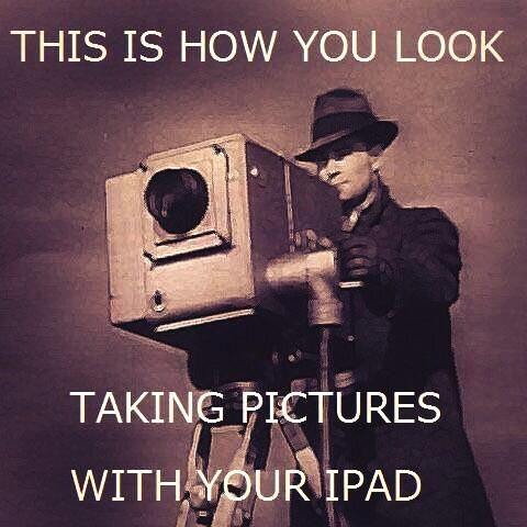 This is how you look taking pictures with your iPad.