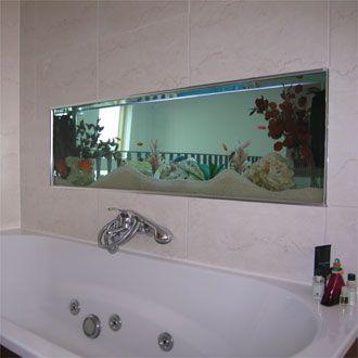 I love the idea of an aquarium wall in the bathroom!