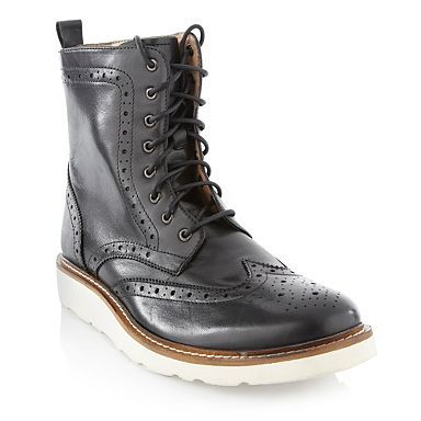 Men's black brogue boots with white soles