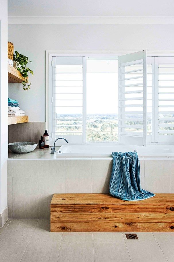 Open shelving serves double duty: practical for storing towels while also lending an opportunity to display some pretty pieces | Home Beautiful Magazine Australia