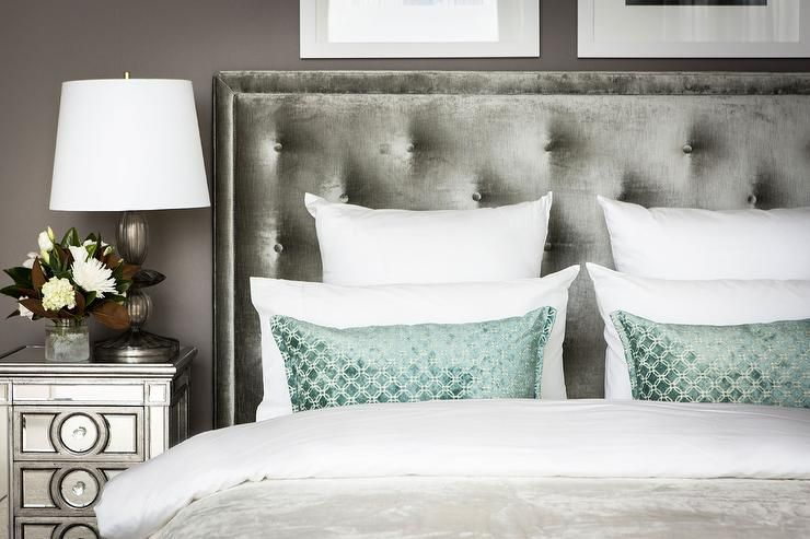Grey Bedroom Features A Dark Gray Wall Lined With A Gray Velvet Tufted Headboard On Bed Dressed In White Bedding Velvet Headboard Headboard Mirrored Nightstand