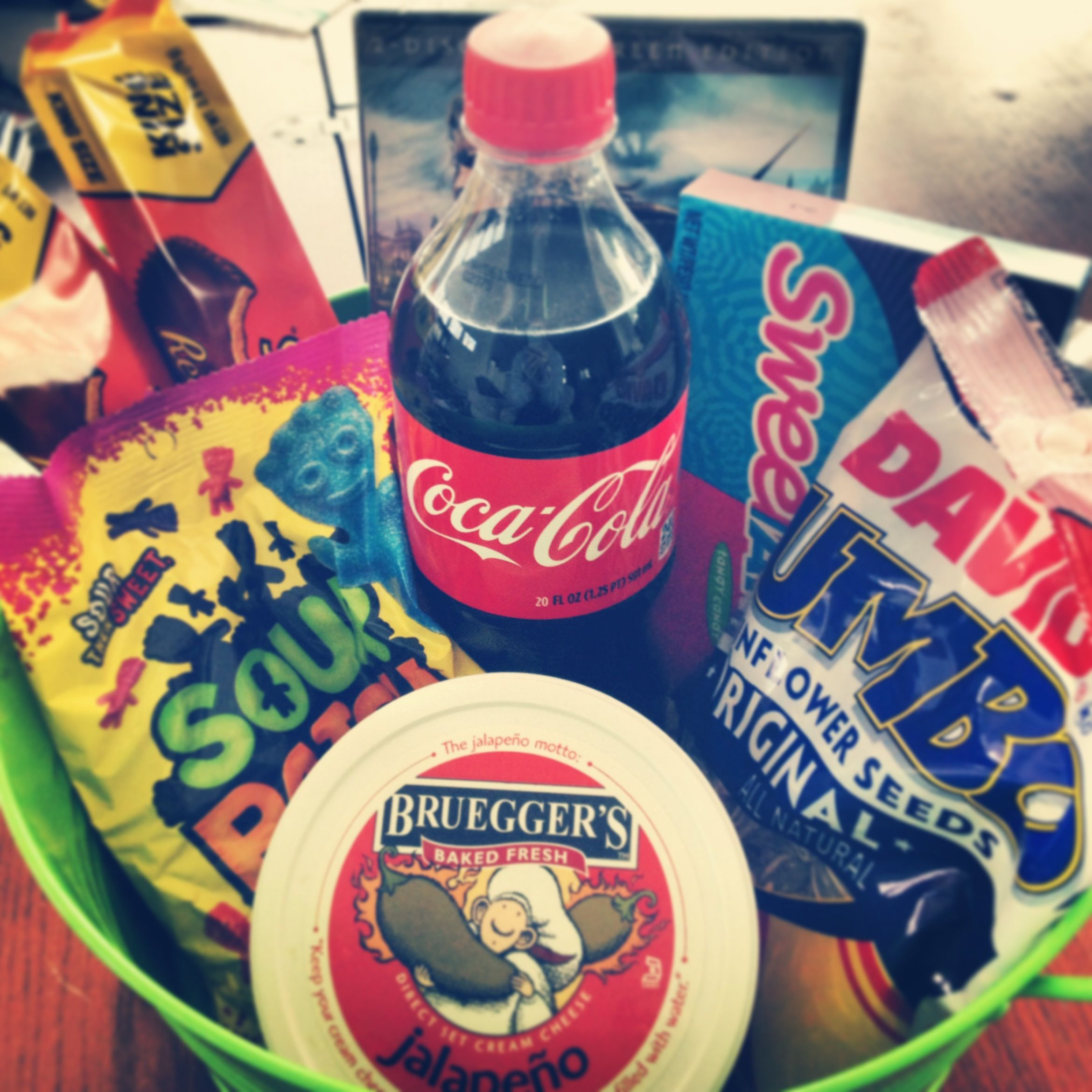Man presents - a basket of his favorite goodies and a movie to watch together! Throw in something specific from one of your favorite local places to really personalize it!