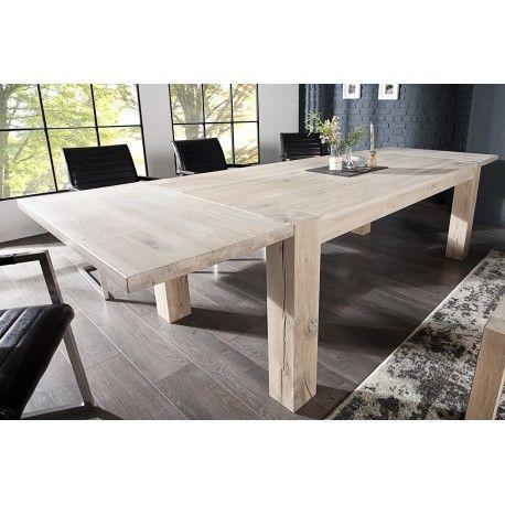 Ravissante table à manger extensible coloris blanc!Composée d'un plateau rectangulaire reposé sur 4 pieds carrés solides en bois massif blanchi et peut accue...