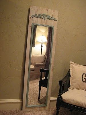 Spray paint an old mirror and add it to wood... Hooks on the sides of the mirror would look great!