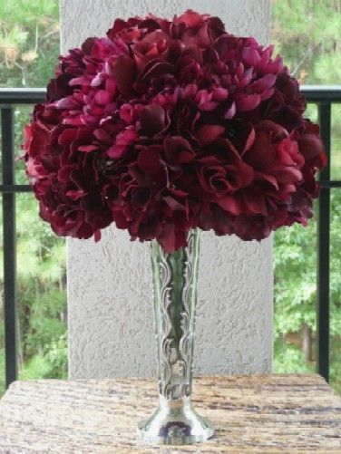 Burgundy silk hydrangea and roses are designed in a dome