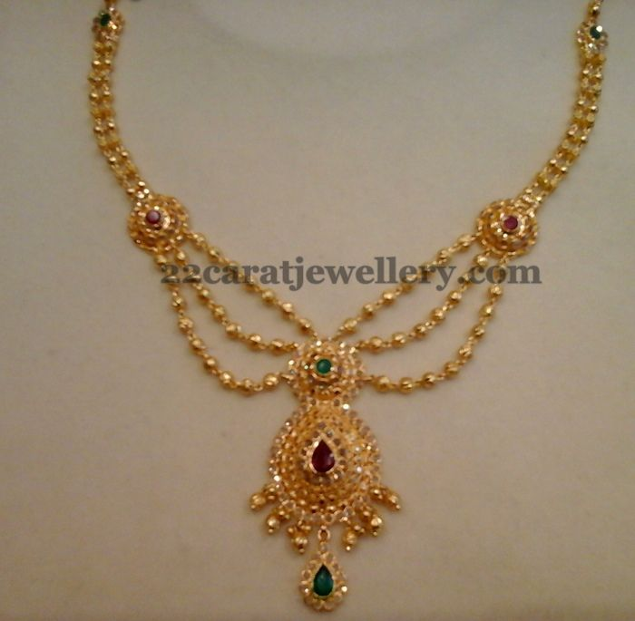 2a28e755bf6 Small round gold balls intricate triple layer short necklace with round  ruby studded motif adorned on the necklace with Two step designer.