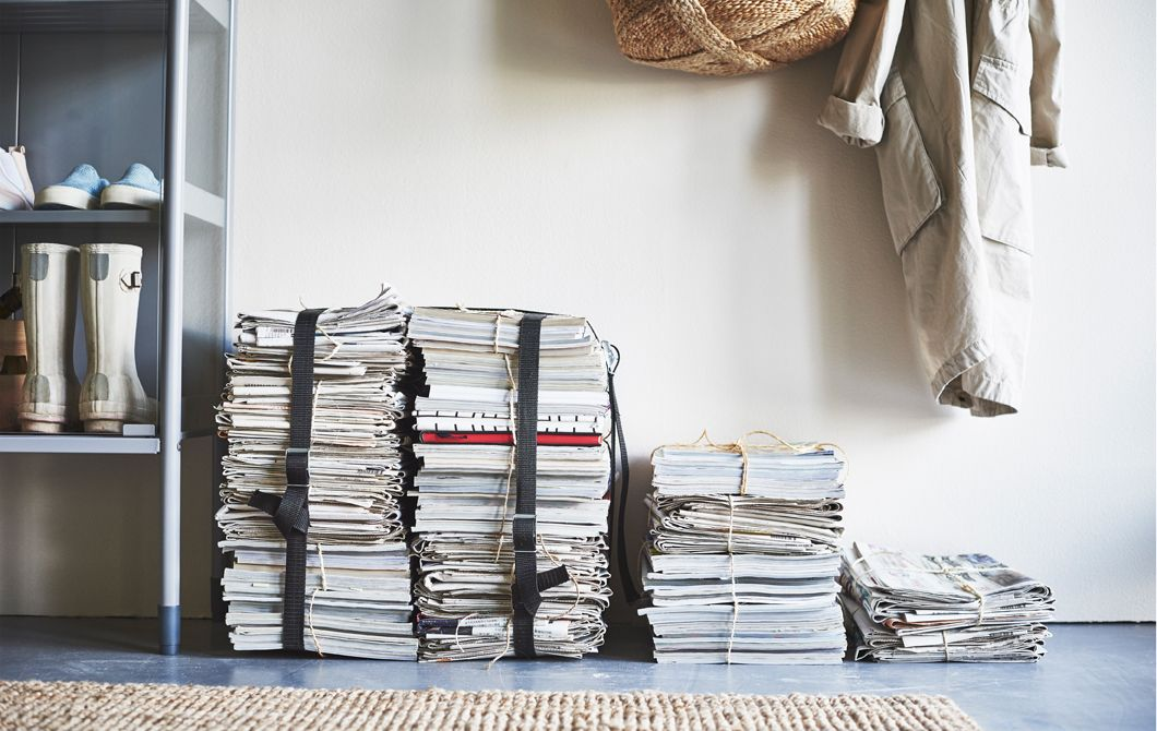 Piles of tied-up magazines and newspaper sit on the floor in a ...