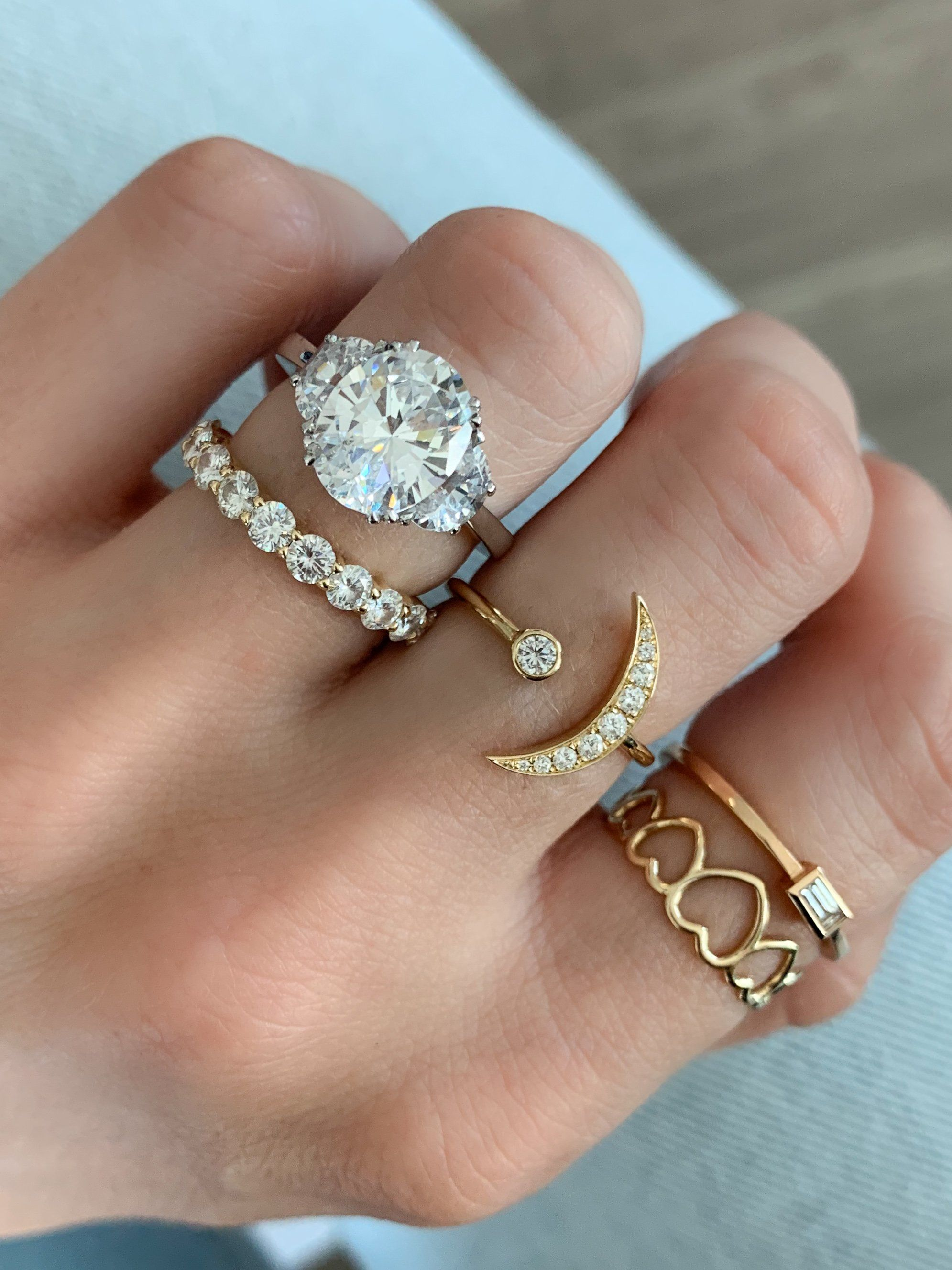 Oval Three Stone Engagement ring with Half Moon Side