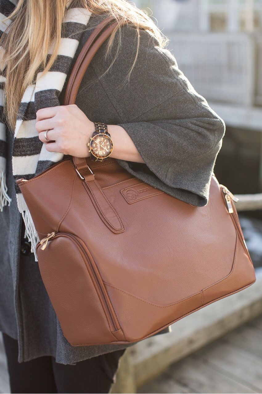 Sarah Wells Annie T Pump Bag In Brown Is The Perfect Accessory To Any Outfit