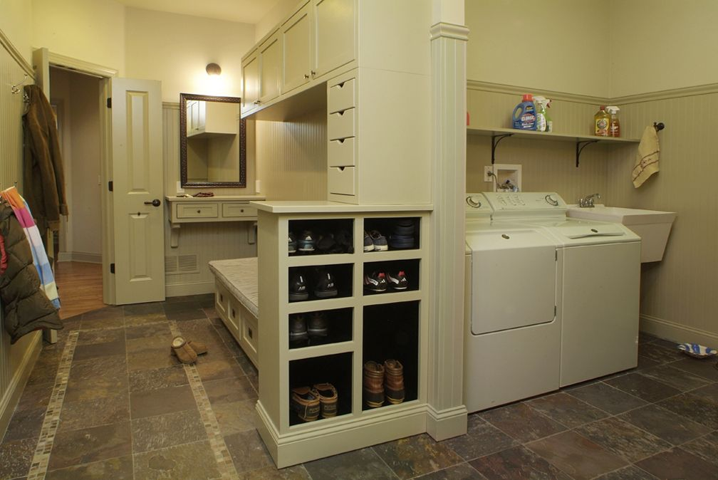 Mudrooms a place for storage sitting and slickers for Bathroom mudroom combo