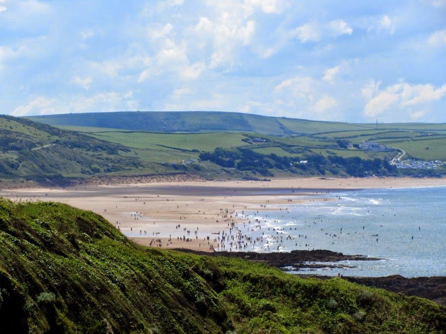 Woolacombe, North Devon. Beach full of holidaymakers on a lovely sunny day.