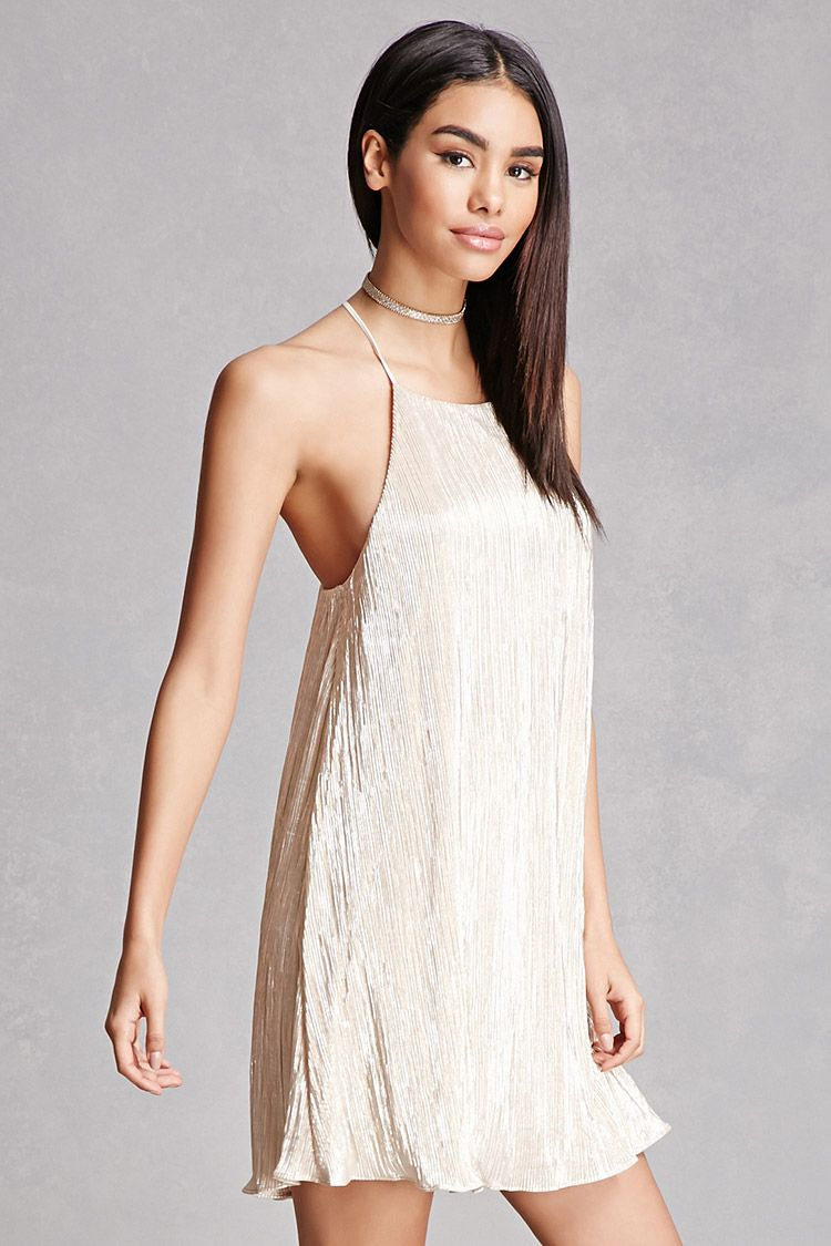 A woven dress by Lush™ featuring an accordion pleated design, metallic sheen, cami straps that turn into a Y-back, a round neckline, and a flowy silhouette.