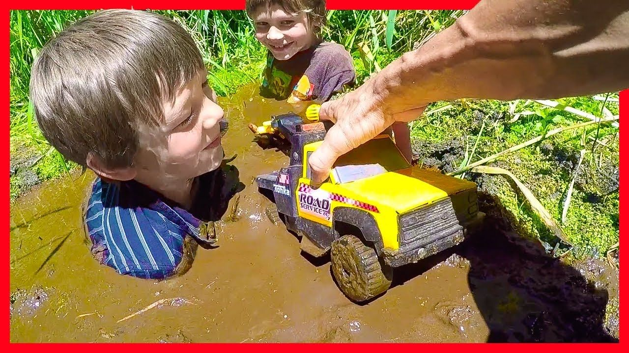 Tow Trucks Stuck In The Mud Axel Show Toy Trucks Youtube Stuck In The Mud Toy Trucks Tow Truck