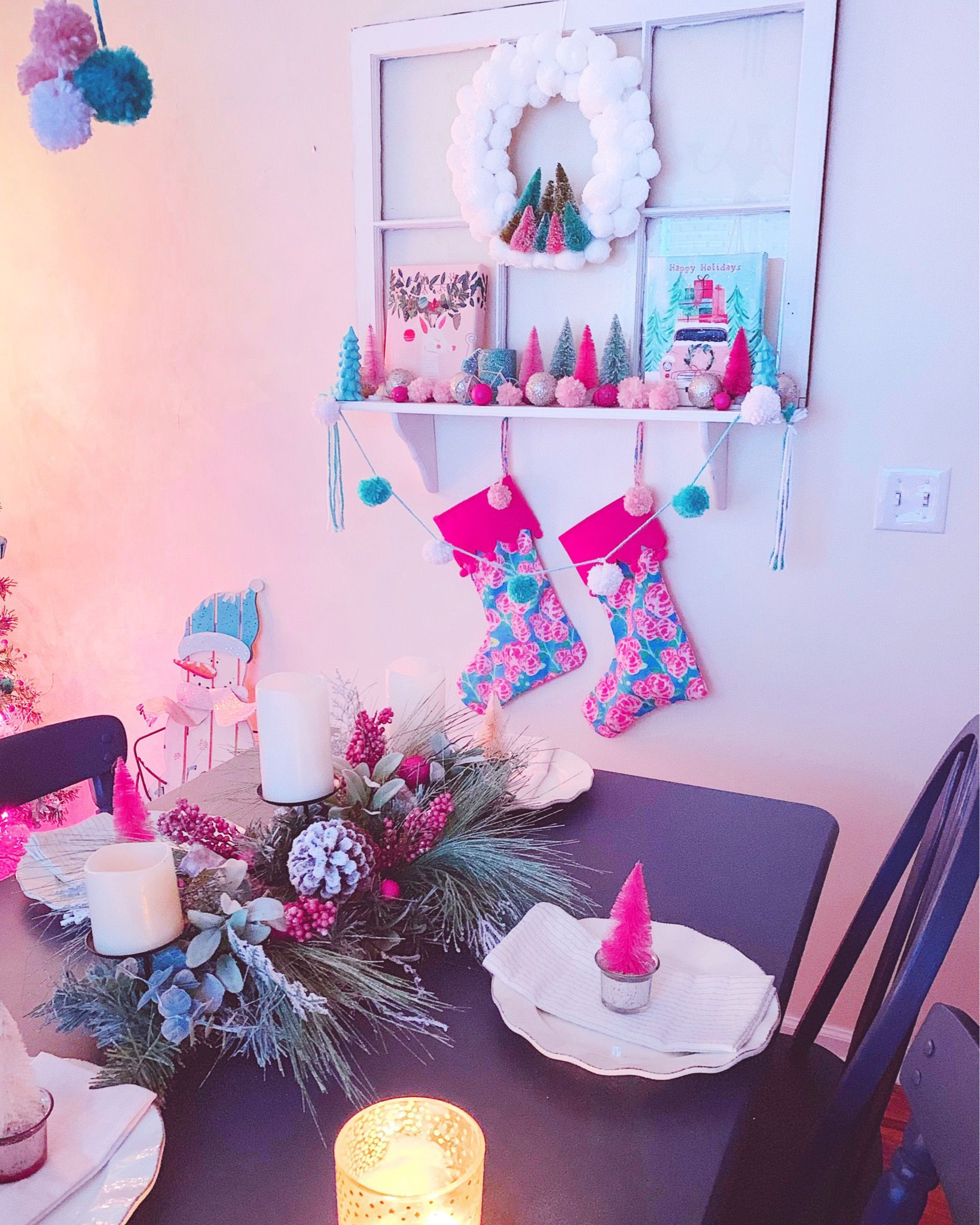A Dining Room Filled With White Pink And Turquoise