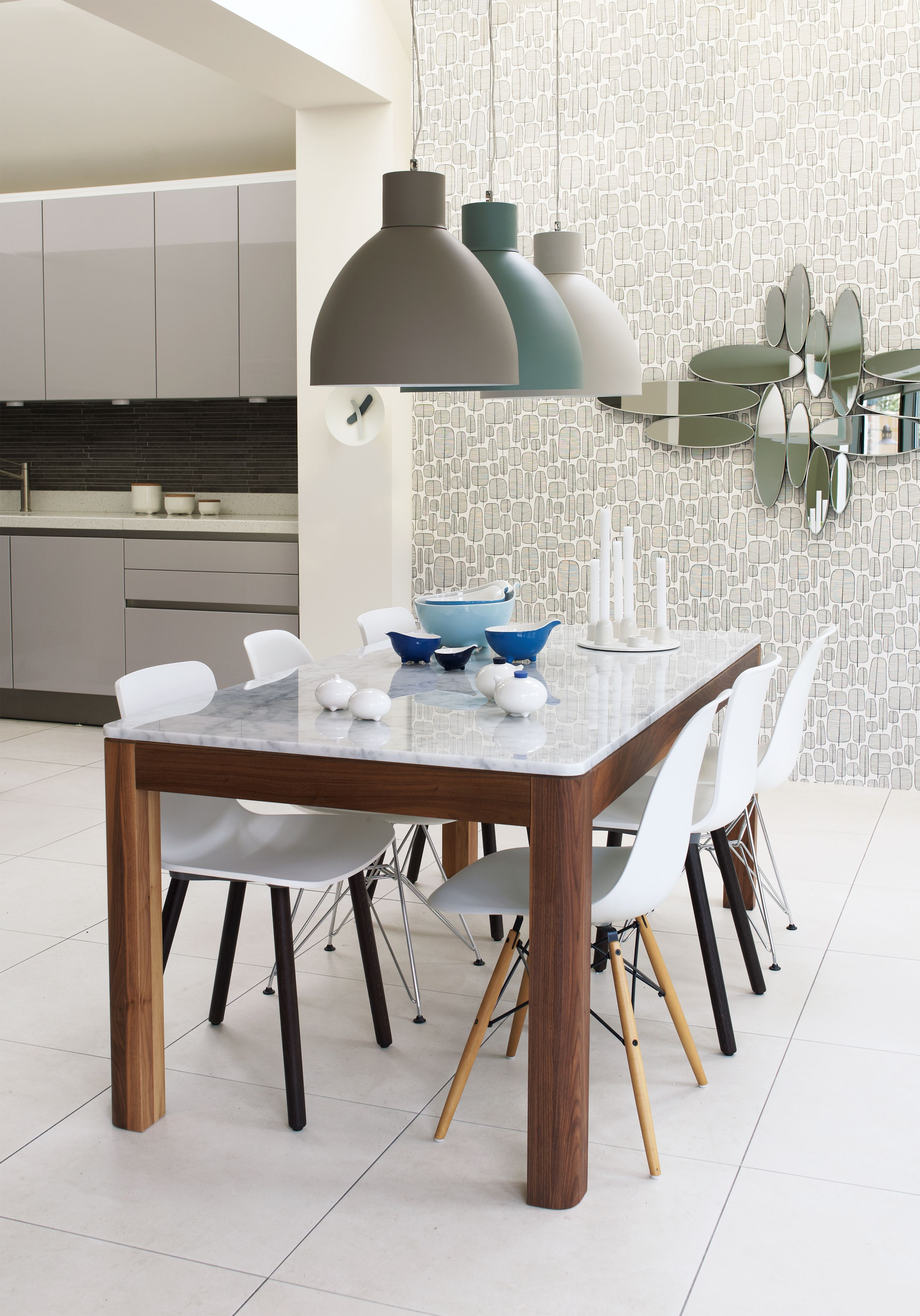 In the kitchen invest in a trio of contrast metal pendant lights in