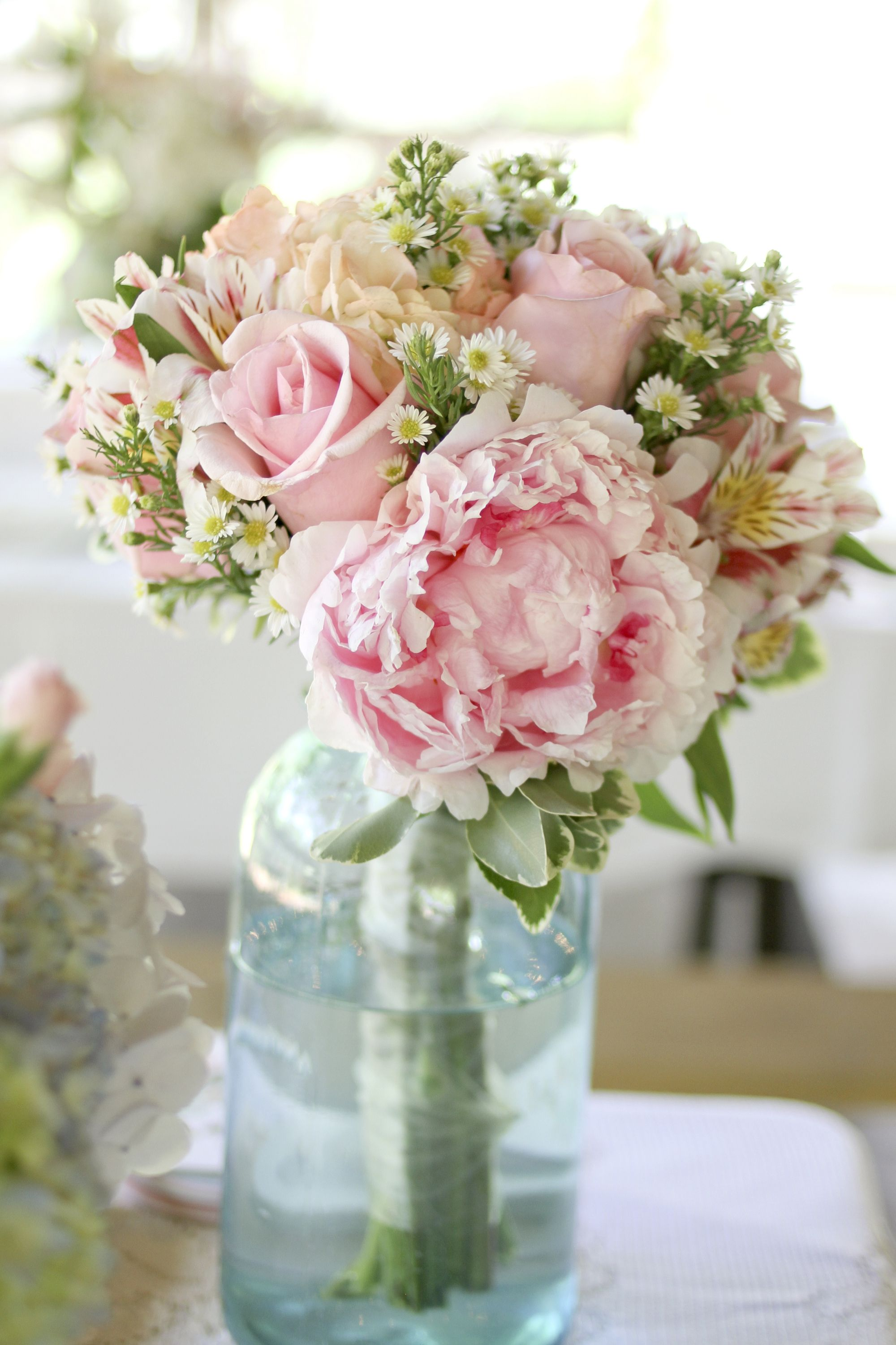 Pink bridal bouquet with peonies roses wildflowers