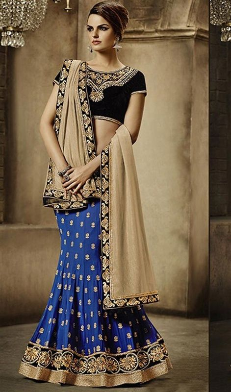 Redefine ethnic stylishness in this blue and beige color georgette embroidered lehenga sari. The lace and resham work appears to be chic and excellent for any function. Upon request we can make round front/back neck and short 6 inches sleeves regular saree blouse also. #georgettelehengasaree #latestdesignersarees #bluecolorolehangasari