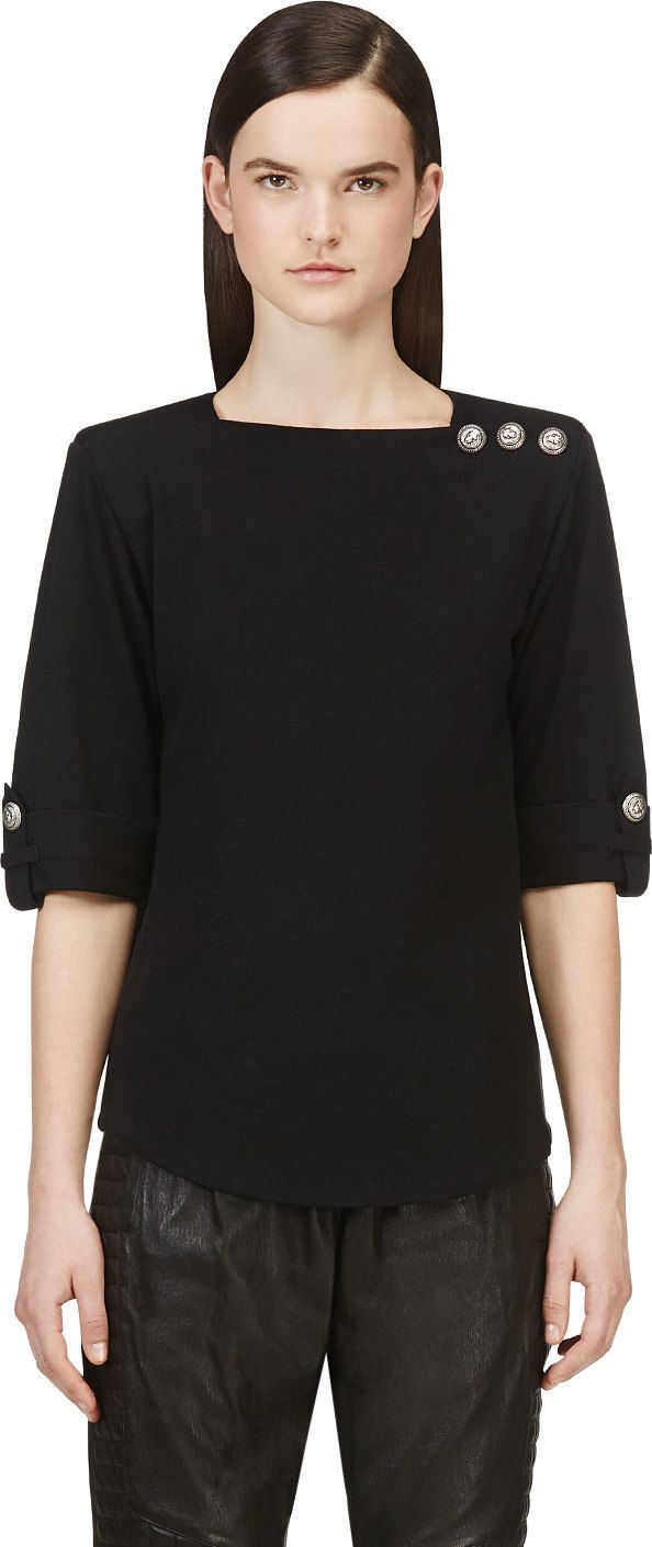 Half-sleeve knit t-shirt in black. Square collar. Button closure at shoulder. Heavily-padded shoulders. Buttoned tab features at sleeve cuffs. Curved hem. Tonal stitching.