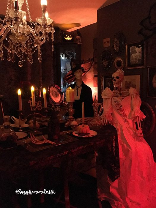 Halloween supper with life size skeletons and spooky lighting - life size halloween decorations