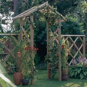 Forest Garden Wooden Forest Rose Arch is part of Rose garden Arch - This Forest Garden Wooden Forest Rose Arch is based upon a traditional garden arch design which appears to be constructed from high quality rustic timbers  The wood used in the classic Rose arch is however modern, each piece is FSC certified and pressure treated carrying a guarantee of 15 years  This garden arch is supplied with extra leg length so you can sink it in to the ground for more durability  Some assembly is required for the Forest Garden Wooden Forest Rose Arch, full comprehensive instructions are given  Forest Garden Wooden Forest Rose Arch Dimensions Height 286cm Width 168cm Depth 70cm Distance between posts 103cm Forest Garden Wooden Forest Rose Arch Features This is delivered flat packed and requires some assembly Comprehensive fixings and instructions are included Supplied with extra leg length for sinking into the ground Rebated trellis side panels  ideal for climbing plants  Planed for a smooth quality finish Made from pressure treated FSC timber This will never need to be treated  15 year antirot guarantee Delivery Information We deliver to all mainland UK but we are unable to deliver to UK Islands and Ireland