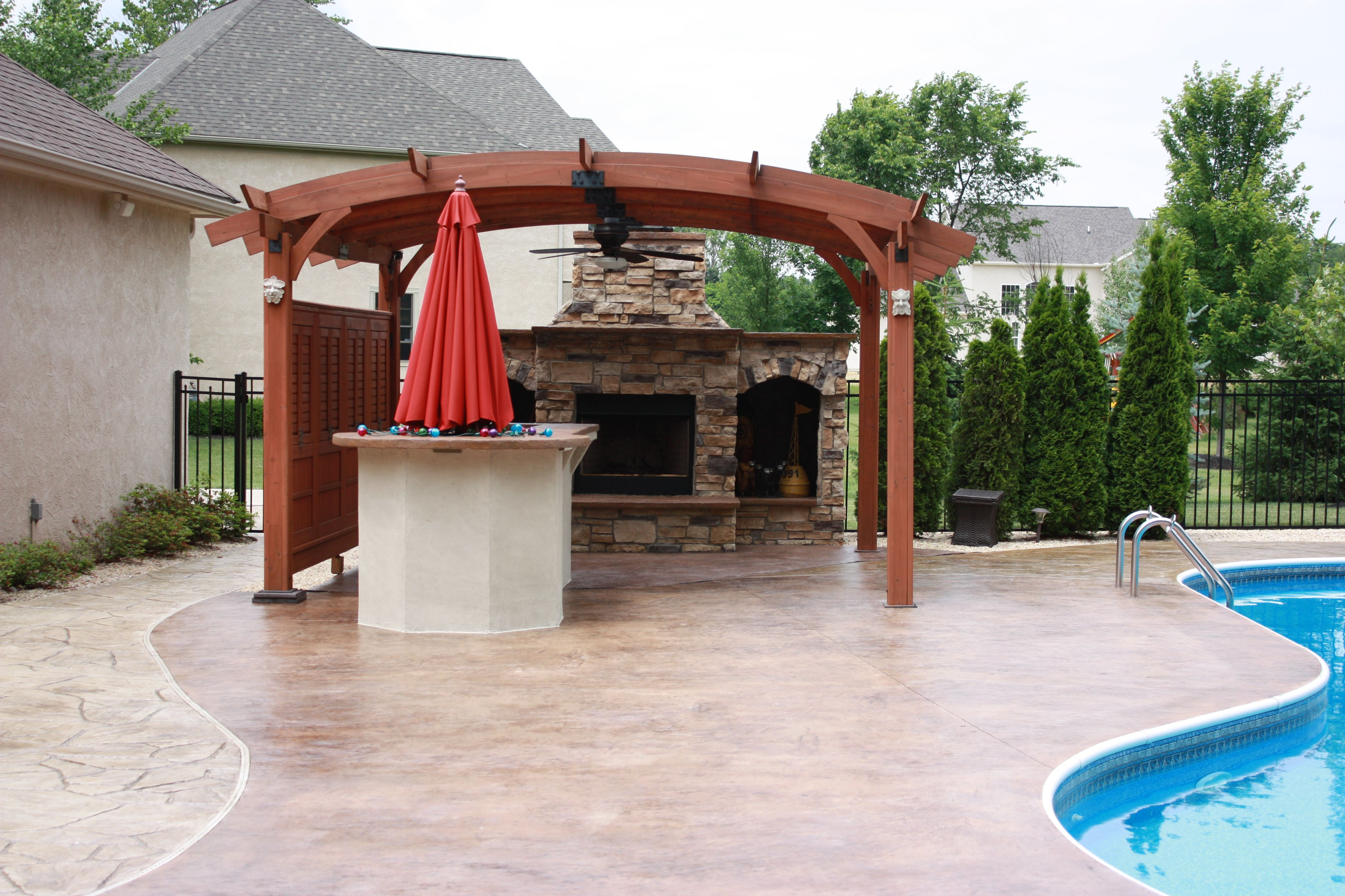 poolside retreat outdoor livingroom with bar and fireplace under