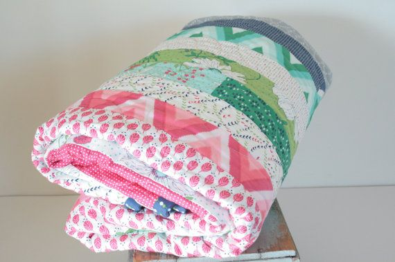 Moda Jelly rolls plus minky backing = this cozy throw quilt. V and Co.s Color Me Happy fabric line is bright and cheerful. All fabrics in this