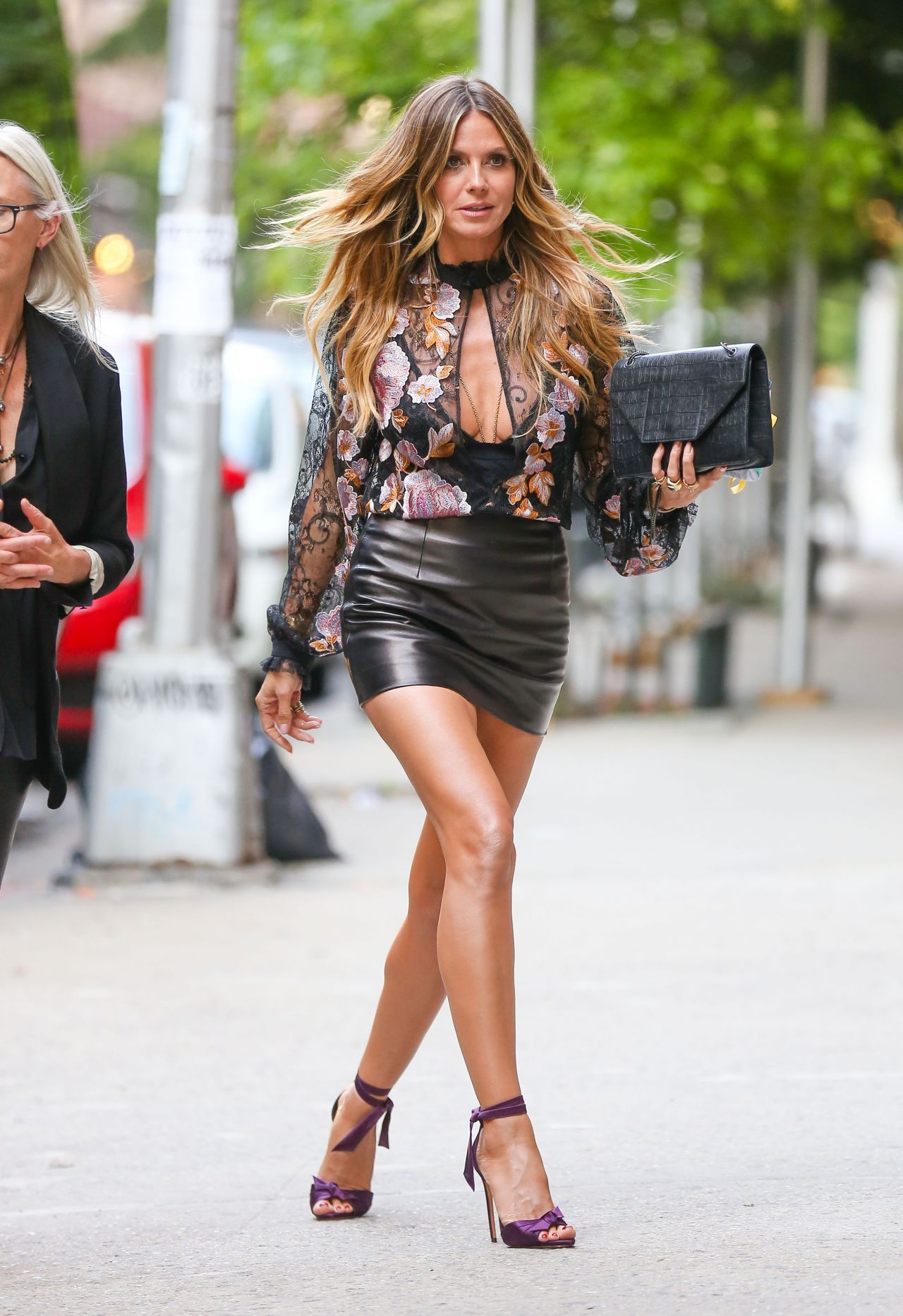 Heidi Klum In A Leather Mini Skirt And Sheer Blouse London