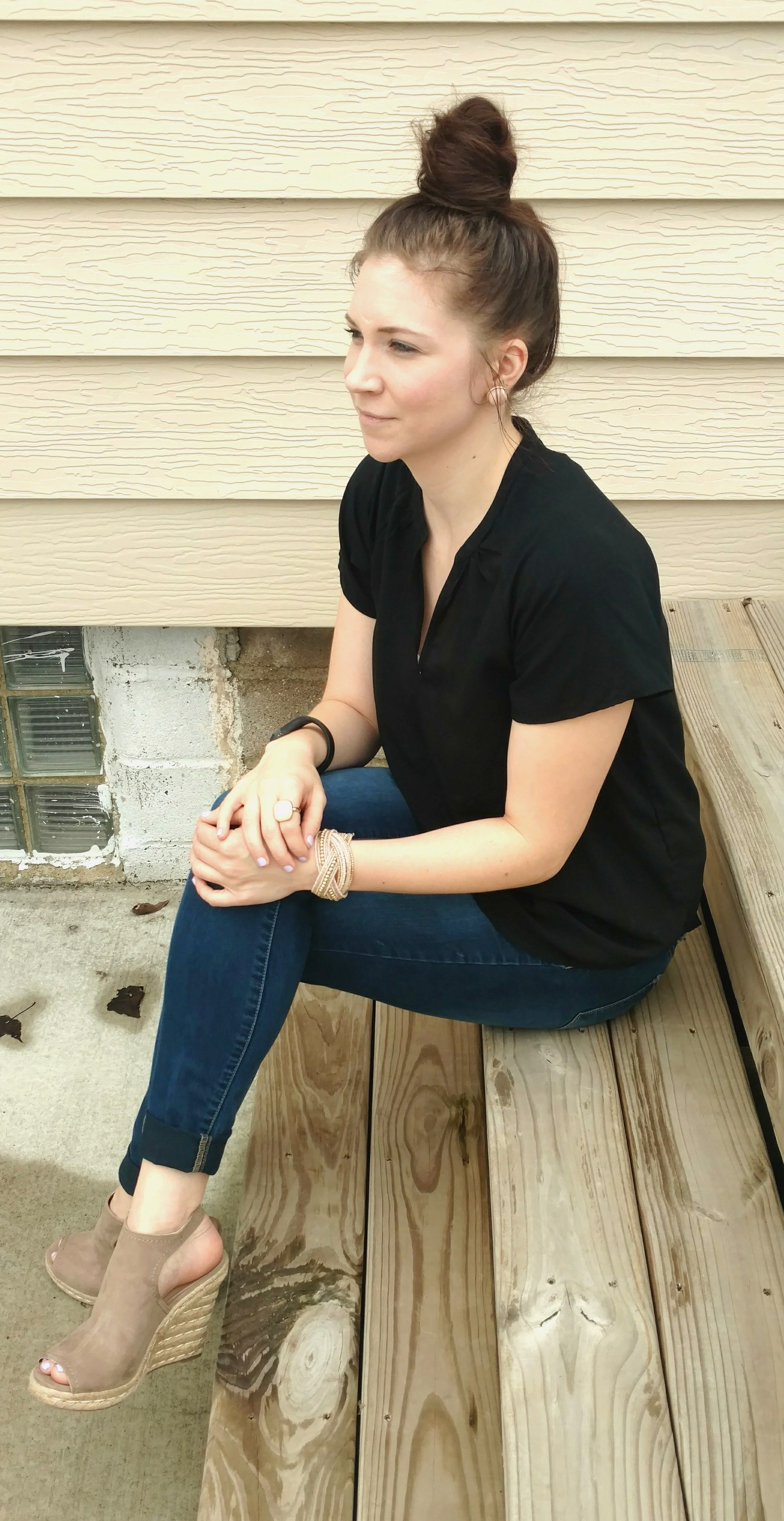 Style by Melissa Ann / / Simple Spring Outfit: jeans, black top, brown wedges, and statement jewelry