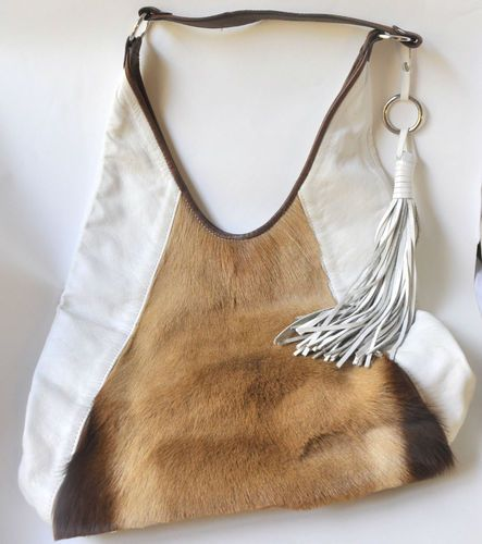 Do you have a love for unique handbags and purses?  This Vintage Clever Carriage Company Shoulder Bag is made of Genuine Leather & Springbok . $600