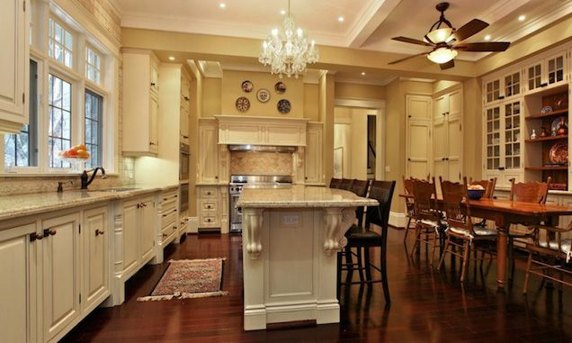 White kitchen island with carved wood corbels under countertop and a ...