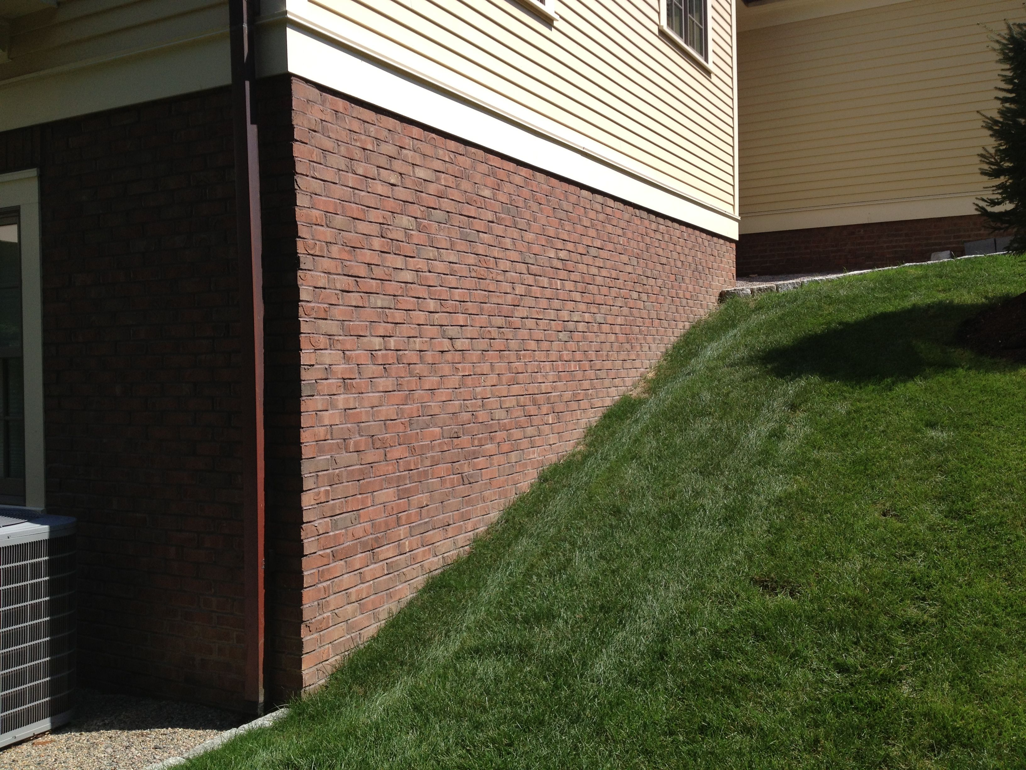 Thin brick veneer installed over concrete foundation by for Concrete block basement