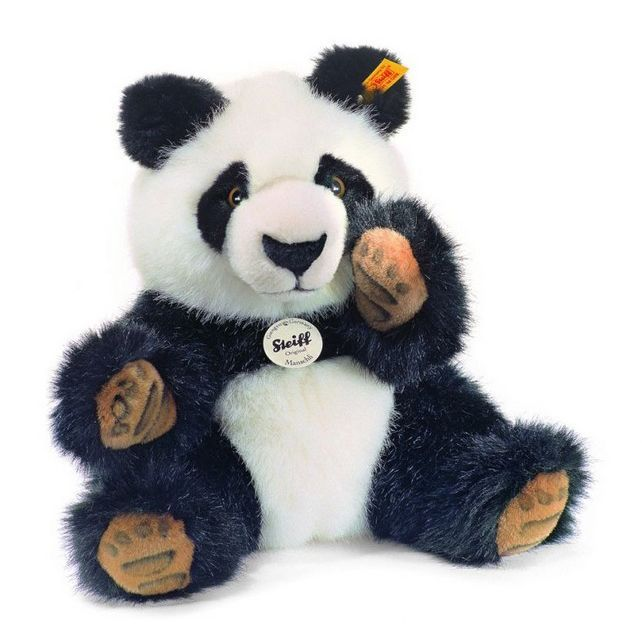 Save 12% - Was £39.99 - Now £34.99  This Steiff Manschli Panda is made from cuddly soft woven fur. Its well-detailed and is the ideal gift for anyone. His black & white Steiff woven fur is incredibly soft to touch.