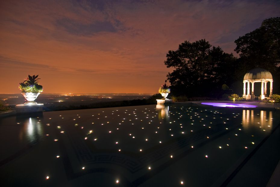 custom infinity edge swimming pool with 200 colored fiber optic star