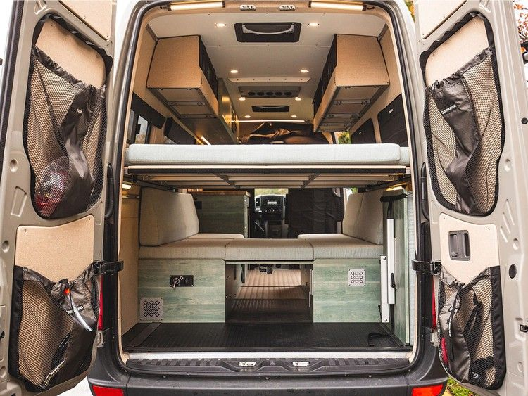 Photo of This custom tiny home on wheels was built inside Mercedes-Benz Sprinter van and designed to be lightweight with cot beds — see inside