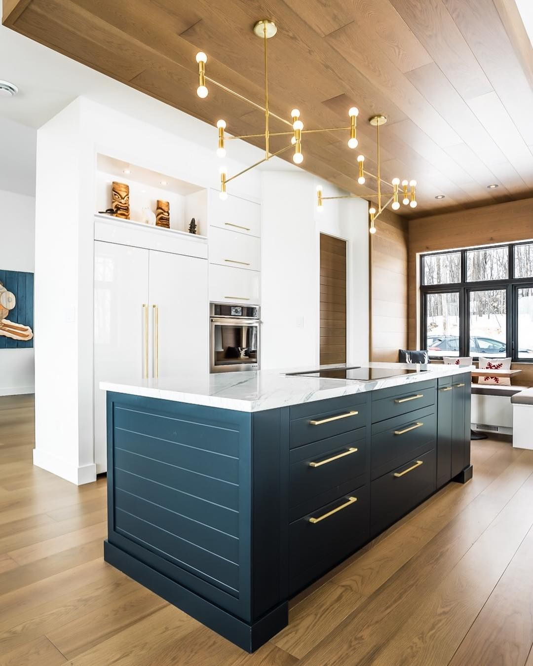 we love the bold island the contrast with the gloss white cabinets and the unreal gold on kitchen remodel gold hardware id=98134