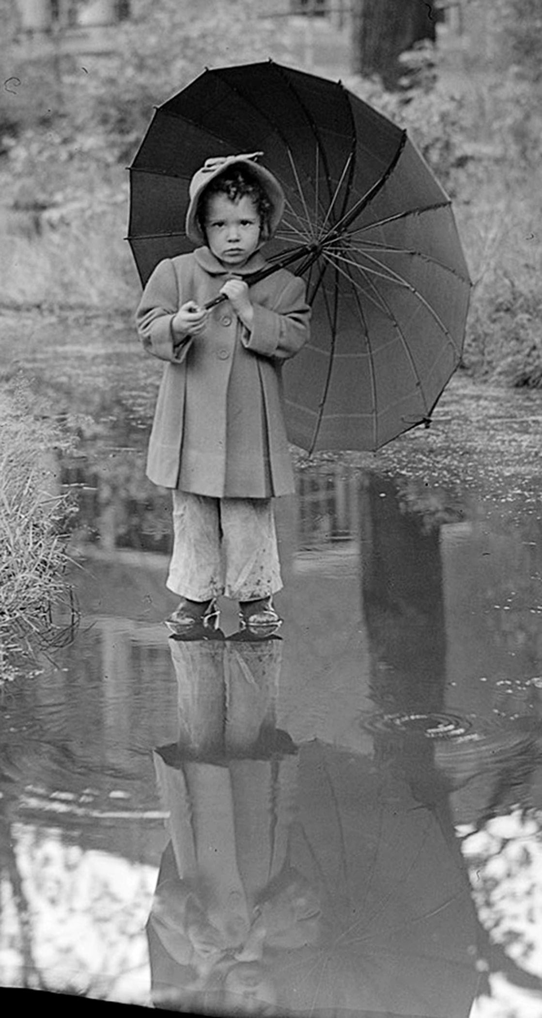 Child Holding an Umbrella (detail).  Photograph by Leslie Jones 1934-56.  Courtesy of the Boston Public Library bpl.org