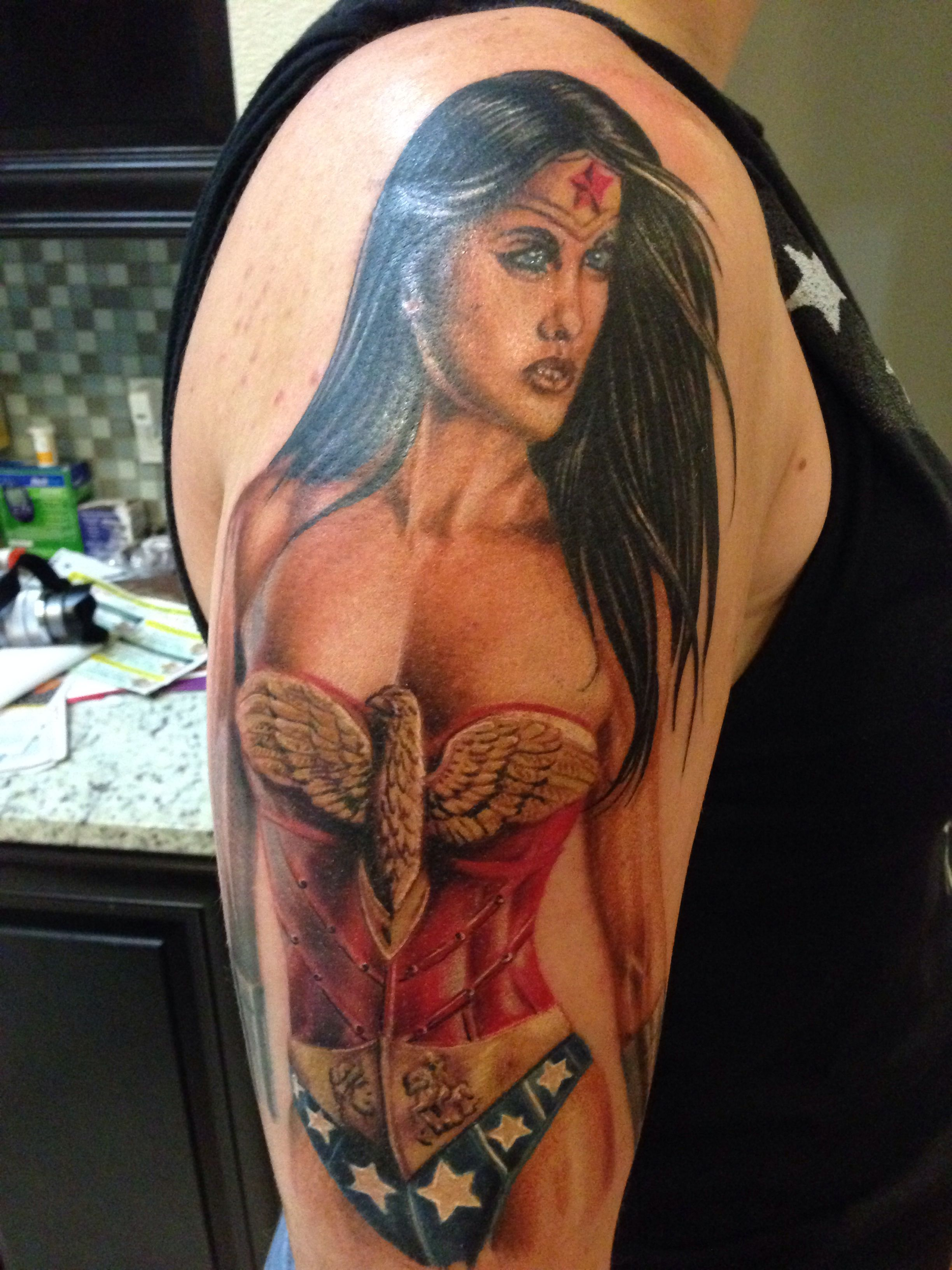 93021acb9 Wonder Woman justice league tattoo start of half sleeve done by mike the  freak at scooters with eternal ink. Love my new tatt!!!