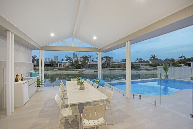 Sandy Cove   Luxury Gold Coast Holiday Homes #beach #waterfront #goldcoast  #australia #holidayhome #outdoor #table #entertaining #pool #rover #patio