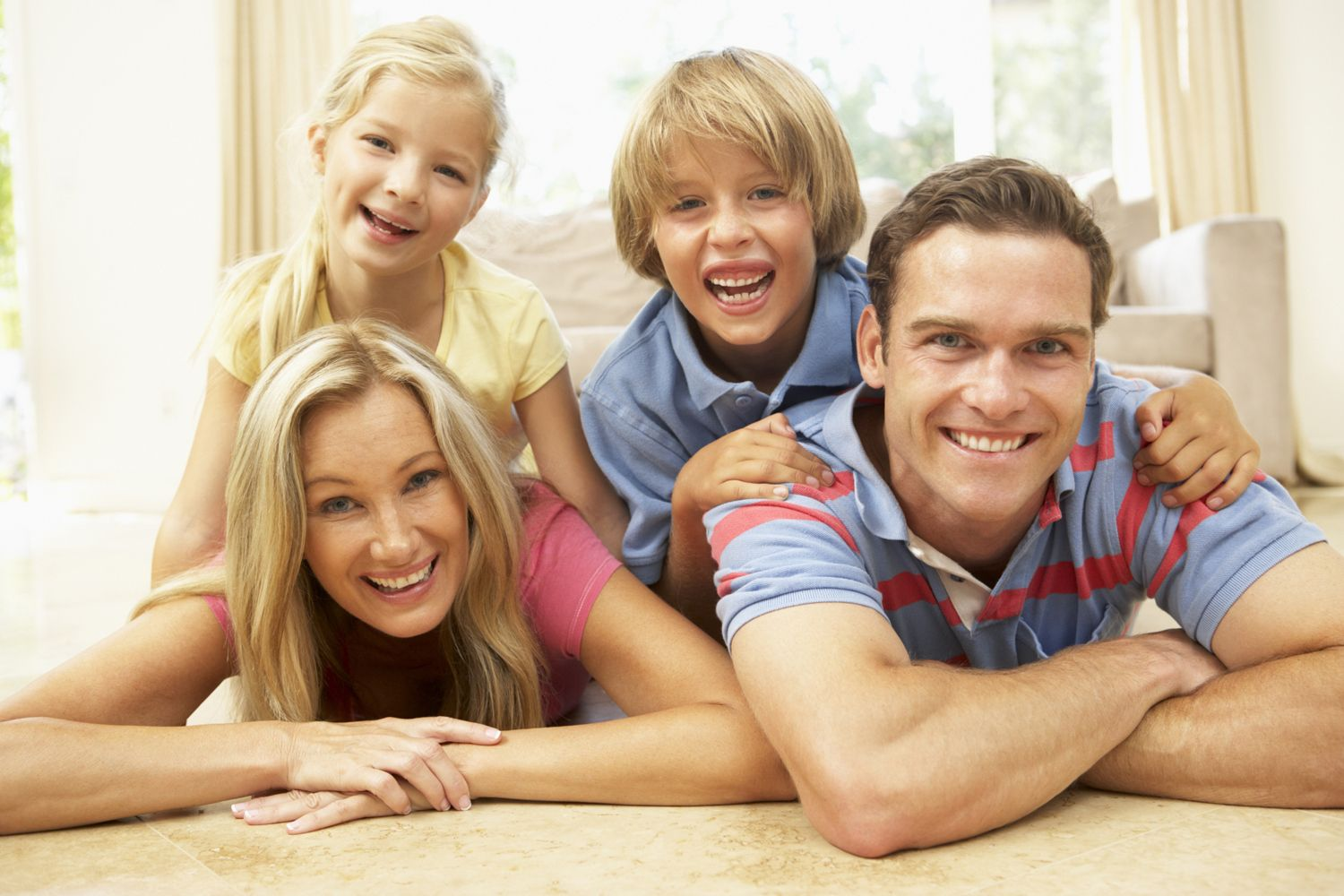 Family Having Fun At Home Together http//www