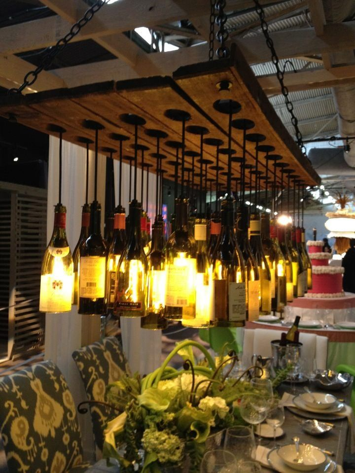 Recycled wine bottle and reclaimed wood chandelier at the 2012 NYC Architectural Digest Home Show