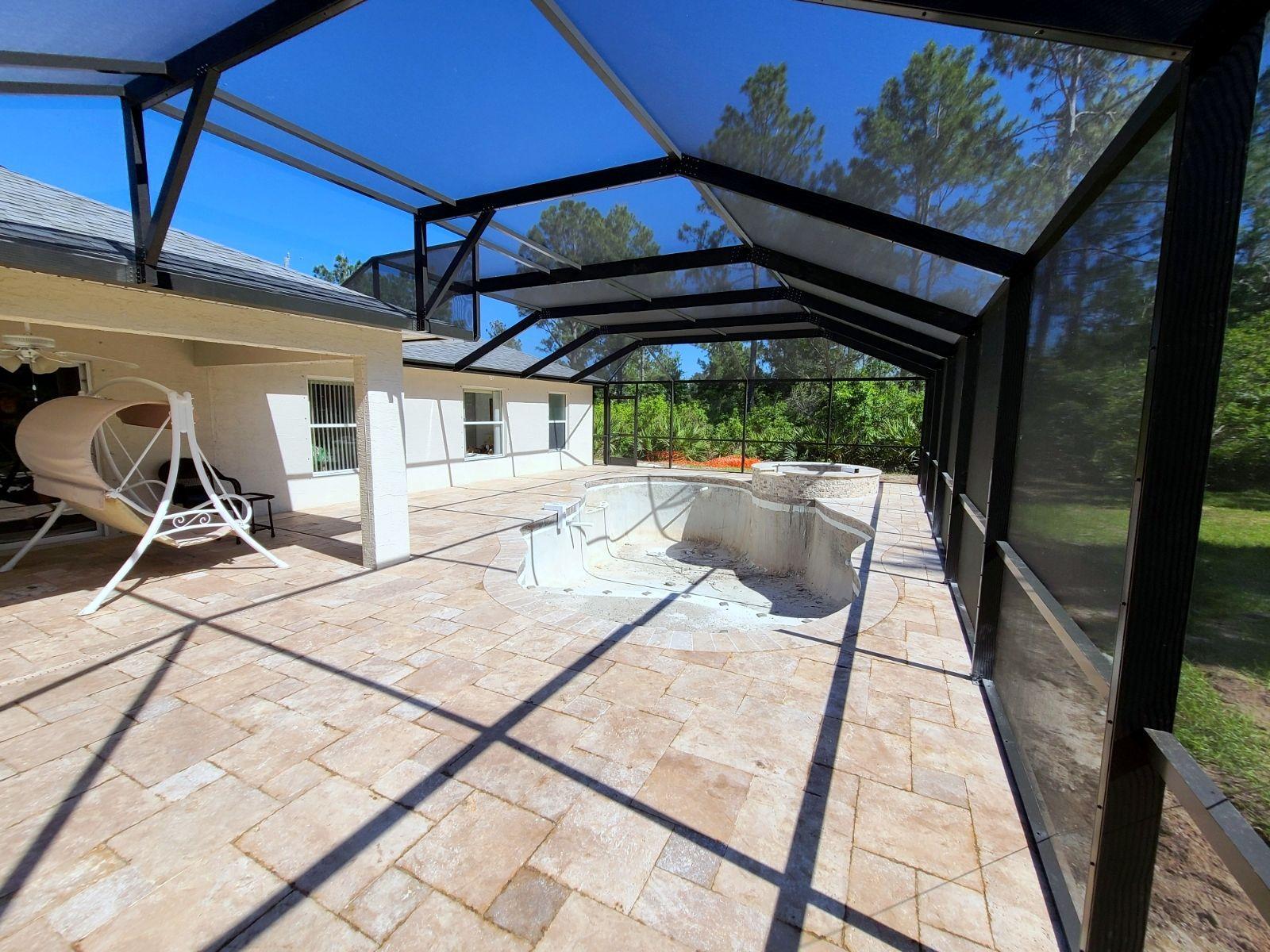 Palm Coast Fl Swimming Pool And Spa Builders Custom Pools Spa Pool Travertine Deck