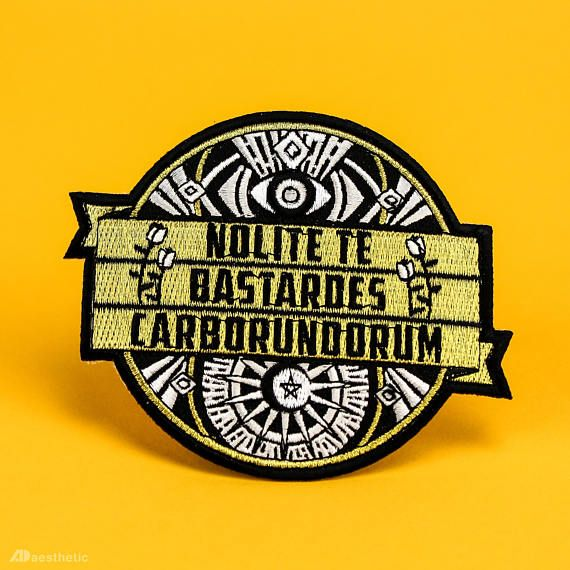 The wisdom of Margaret Atwood is timeless: Dont let the bastards grind you down. This iron on patch features metallic gold thread and is the perfect accessory for fans of the classic The Handmaids Tale. This embroidered cloth badge is a fun and simple way to personalize your look, and can
