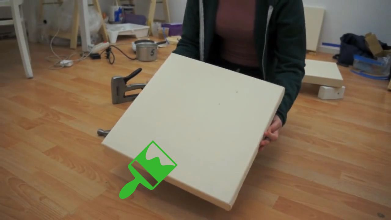 Video tutorial on how to stretch a rolled canvas painting