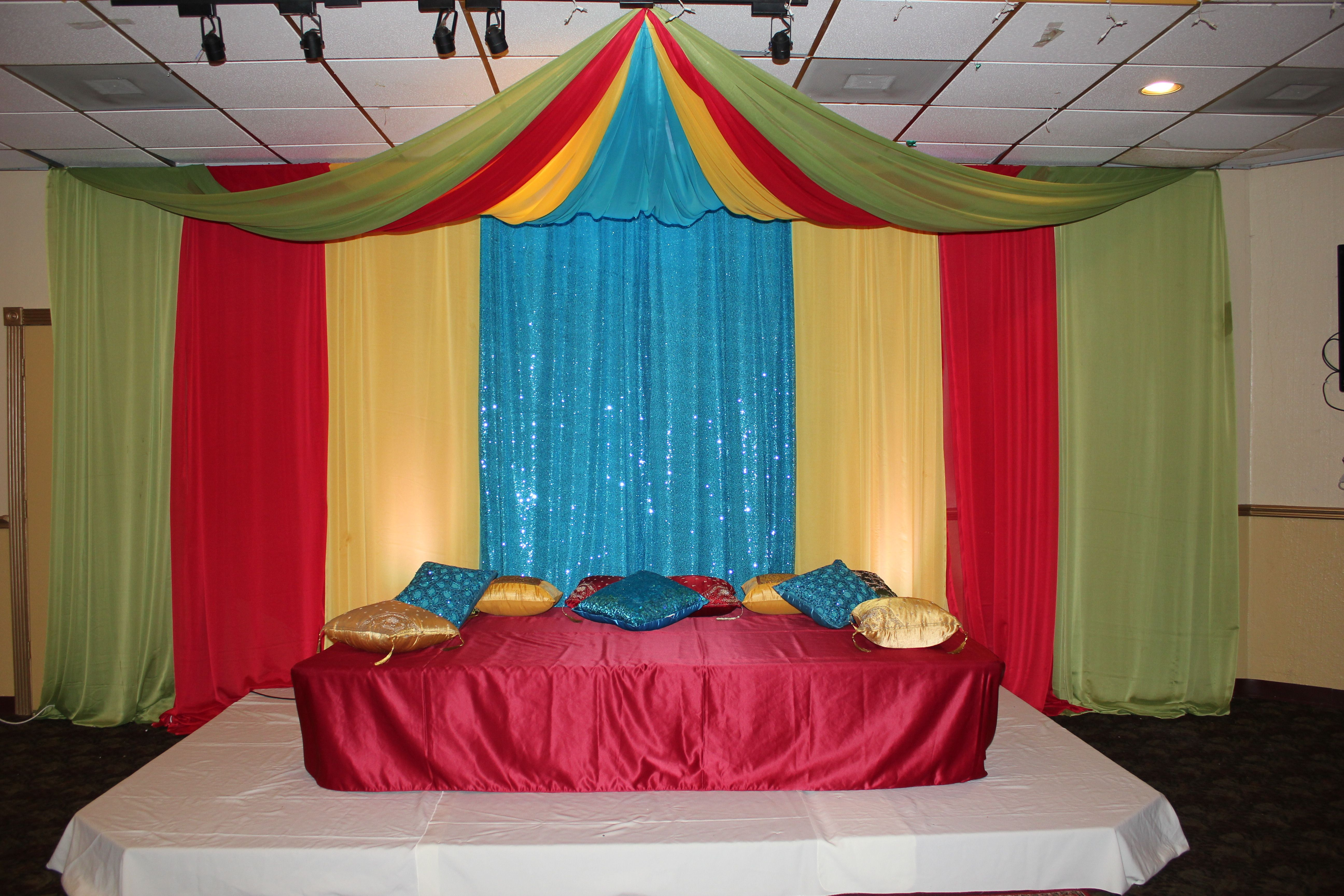 stage backdrop for mehndi with canopy in green red yellow turquoise - Green Canopy Decoration