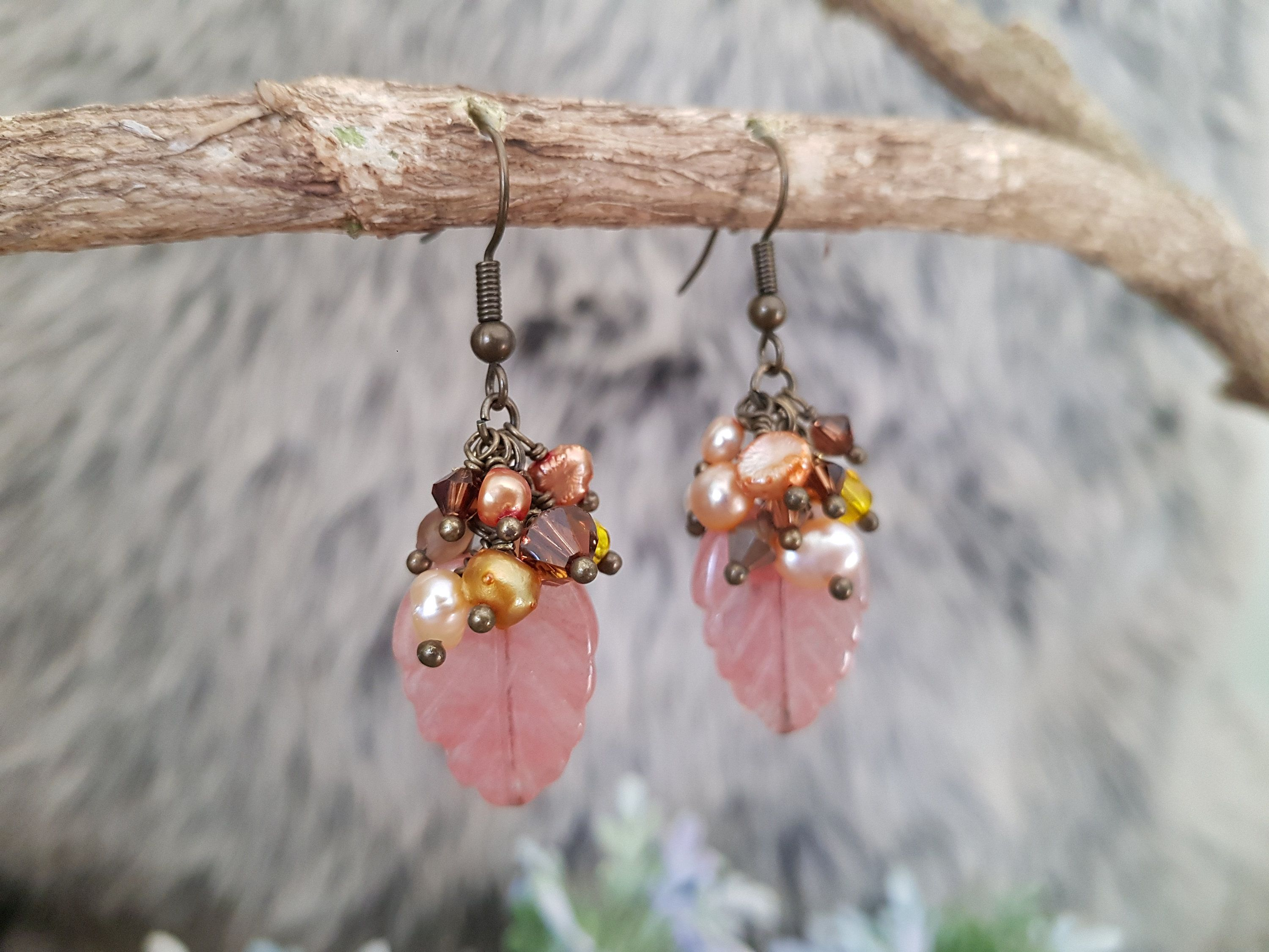 Beautiful earrings with a natural stone bead and a silver ear hook