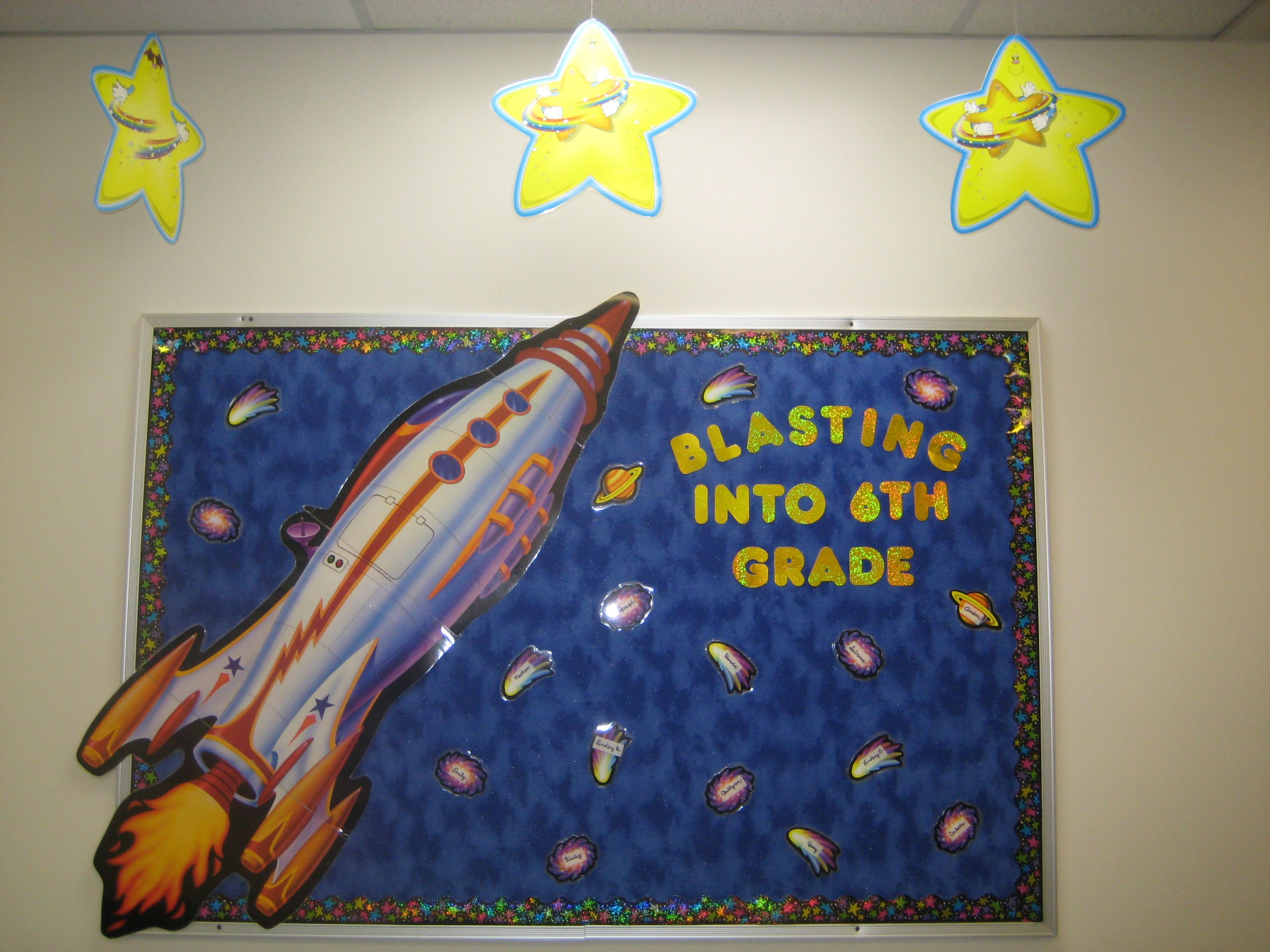 Space theme welcome board using fabric as the background for Space themed fabric
