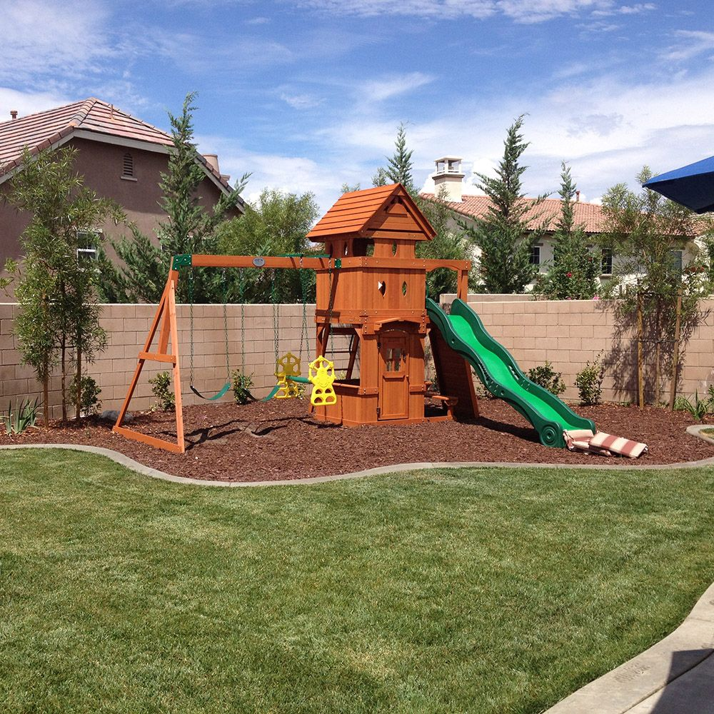 How to landscape under a swing set helpfulhowtos for Play yard plans