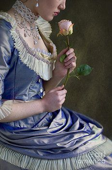 Victorian woman holding a single rose by Lee Avison